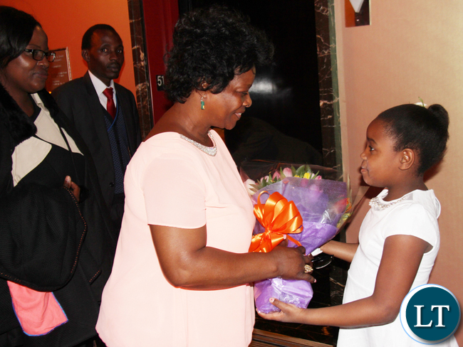 First Lady of Zambia Mrs. Esther Lungu receiving a bouquet of flowers from Vanessa Brown Mwanza on arrival in New York. The First Lady will participate in the 60th Session of the Commission on the Status on Women at UN Headquarters. PHOTO | Chibaula D. Silwamba | Zambia UN Mission