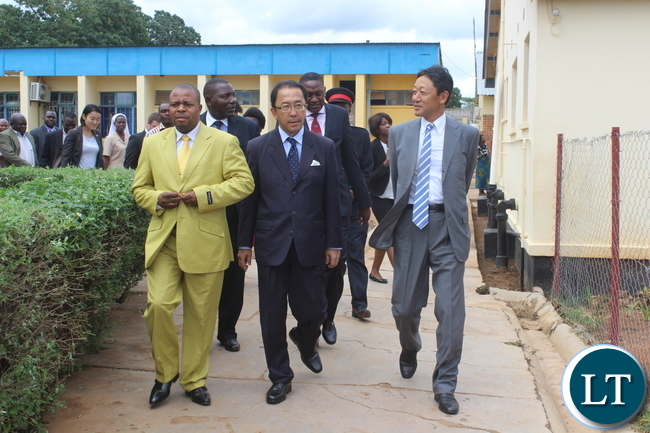 Japanese Ambassador to Zambia Mr. Kiyoshi Koinuma (centre) and Fuji Film South Africa President Mr. Ryosuke Miki being led by Monze Mission Hospital Acting Medical Superintendent Dr Kakanda Ngalukela(left) during the tour of the Hospital after handover of the Digital X-Ray machine to the Health institution