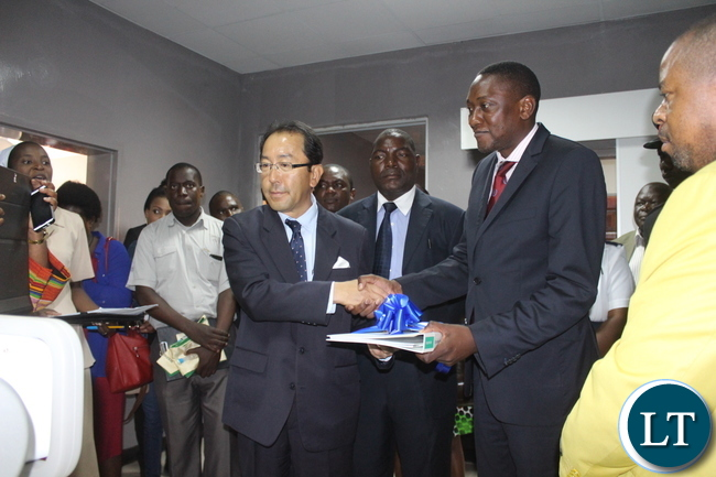 Japanese Ambassador to Zambia Mr. Kiyoshi Koinuma(left) officially hands over the Digital X-Ray to the Director of Clinical care and Diagnostic Services Dr Kennedy Lishimpi (Right) who received the equipment(not in picture) on behalf of the Ministry of Health