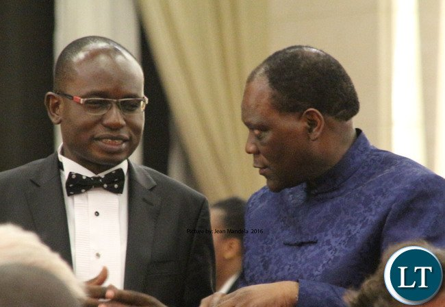 President press Aide Amos Chanda with the Secretary to the cabinet Dr Rolan Msisika