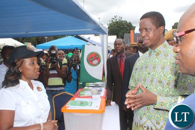President Edgar Lungu talking with ECZ spokesperson Sylvia Bwalya .