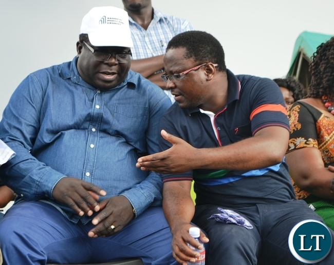 INFORMATION and Broadcasting Minister Chihimba Kambwili(left) confers with Kitwe DC Chanda Kabwe before the PF rally started at Mukuba grounds in Kitwe .Picture by KENNEDY MUPESENI