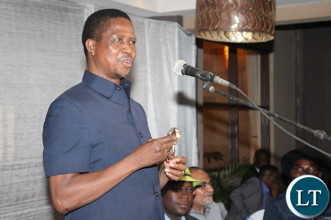 PRESIDENT Edgar Lungu, shows off his Ten thousand Dollars' worth wrist watch which was bought at K 50,000-00 at a PF fundraising dinner held at Protea Hotel in Chipata
