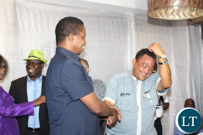 VALDEN Findlay shows off President Edgar Lungu's wrist watch after successfully bidding for it when it was auctioned during a PF fundraising dinner held at Protea Hotel