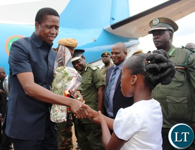 PRESIDENT Edgar Lungu shakes hands with eight years old Judith Banda after receiving a bouquet of flowers from her on arrival at Chipata airport