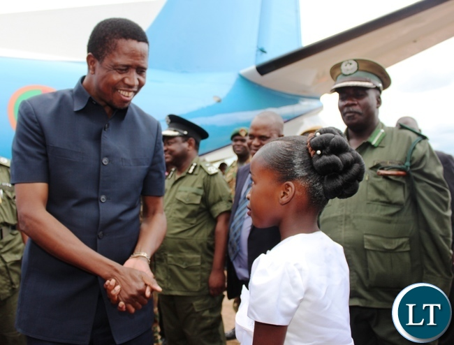 PRESIDENT Edgar Lungu talks to Judith Banda after she presented a bouquet of flowers to him on arrival at Chipata airport