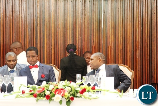 President Edgar Lungu chat with his Mozambique counterpart Filipe Nyusi during a state banquet at state house in Maputo