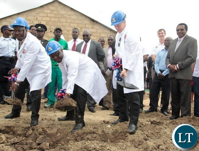 Minister of Local Government and House,Stephen Kampyongo (c),His Worship the Mayor of the Greater City of Lusaka,George Nyendwa and United States Ambassador to Zambia Mr.Eric Schultz, during the ground breaking in Garden Compound