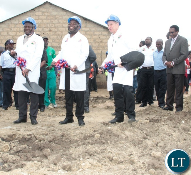 Minister of Local  Government and House,Stephen Kampyongo (c),His Worship the Mayor of the Greater City of Lusaka,George Nyendwa and United States Ambassador to Zambia Mr.Eric Schultz, a light moment during the ground breaking in Garden Compound