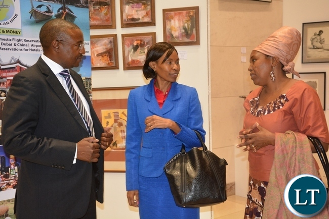 Commerce Permanent Secretary Kayula Siame(c), U.S Embassy President of America Chamber of Commerce Jason Kazilimani(l) and PF Chilanga aspiring candidate Maria Phiri(r) having a light moment during the American Chamber of Commerce Annual General Meeting at the American Embassy