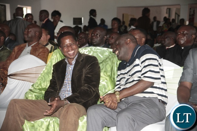 President Edgar Lungu singing a song shares a light moment with PF secretary General Davies Chama Left When he attended a church service at Blessed of Hope Church