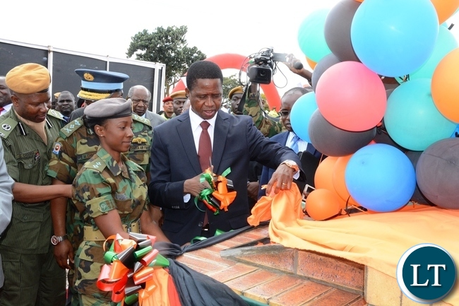 President Edgar Lungu cutting the ribbon to officially the ground breaking ceremony of ZAF twin Palm Public Private Partnership Project on Support Social Amenities and Commercial Facilities whilst Lt Muwindwa Liusha looks on