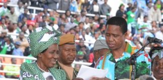 President Lungu and Vice President Inonge Wina looking at the PF 2016-2021 manifesto at the lunch of PF Campaign in the Heroes Stadium