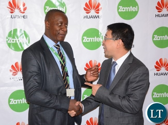 Zamtel CEO Mpanga Mwanakatwe and Managing Director Huawei Spawn Fan Wen having a light moment after Signing MOU of a Corporate Social Responsibility with Huawei Zambia provided 200, 000 USD and Zamtel Commitment to spend K2 million
