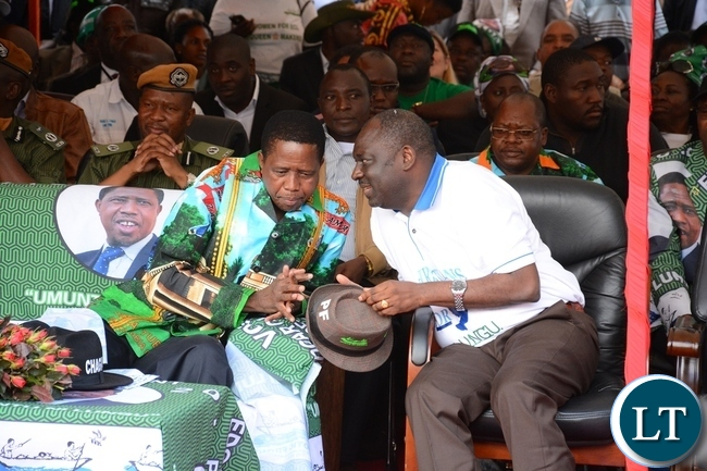 President Edgar Lungu chat with PF Secretary General Davies Chama at the lunch of PF Campaign in the Heroes Stadium