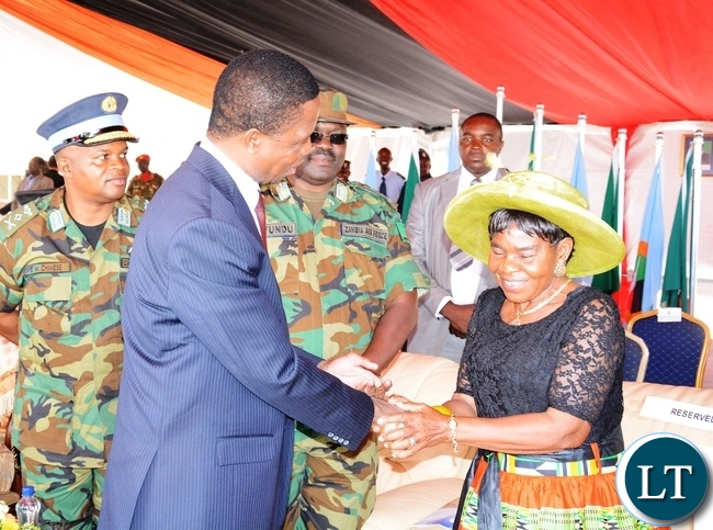 President Edgar Lungu greets Chieftness Nkomesha Mukamambo II at the official ground breaking ceremony of ZAF twin Palm Public Private Partnership Project on Support Social Amenities and Commercial Facilities whilst Lt Muwindwa Liusha looks on