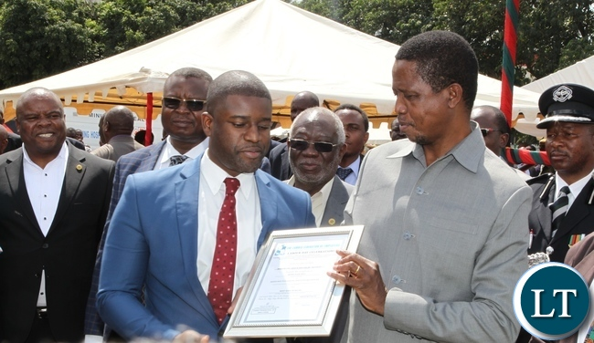 President Edgar Lungu giving Moses Sefu of Ministry of labour award of Hard working at Labour Day celebrations