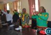 Representatives of political parties in Livingstone flash their different party symbols at the Civil Centre