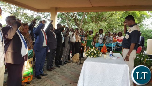 President Lungu and PF leaders on the Copperbelt sings the national anthem at the start of the meeting