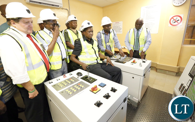 President Lungu tour Synclinorium Shaft at Mopani operation room operates the Shaft gear in the Control Room - Picture by Eddie Mwanaleza 05th May 2016.
