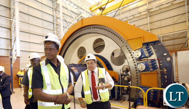 President Lungu with mopani Chief Executive officer Mr Johan jansen tour Synclinorium Shaft at Mopani operation room operates the Shaft gear in the Control Room - Picture by Eddie Mwanaleza 05th May 2016.