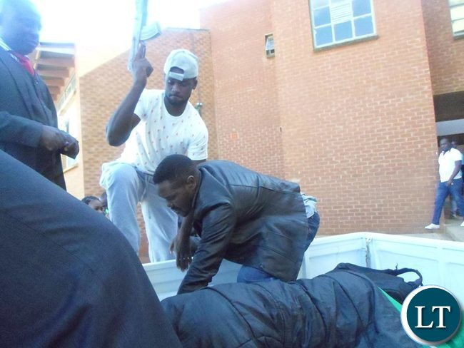 Ritual murder suspects bundled in the van after leaving court