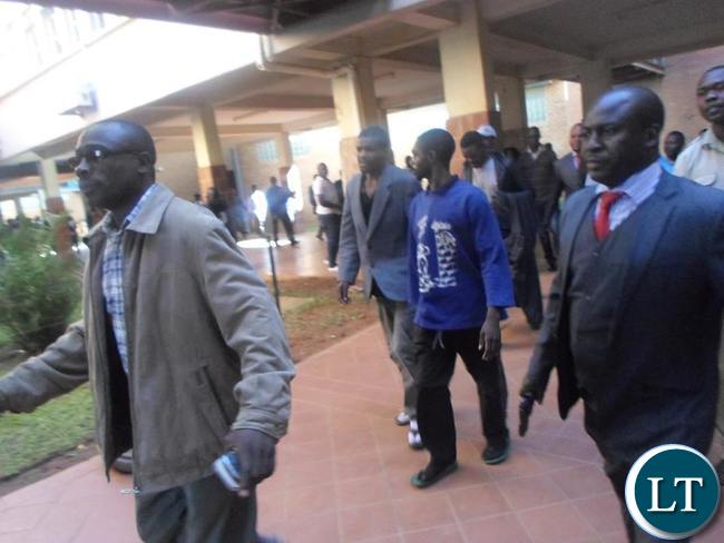Suspects in the ritual murder case leaving court