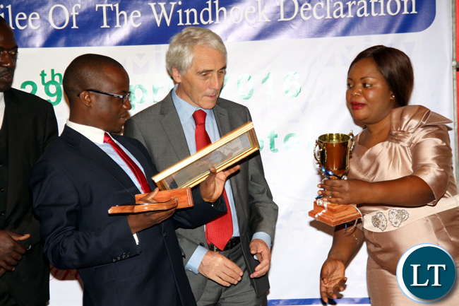 Tom Njovu (l) of ZNBC and MISA Zambia chairperson Hellen Mwale gesture during the awarding of receipients during the 2016 MISA Zambia annual awards in Lusaka on April 29, 2016.
