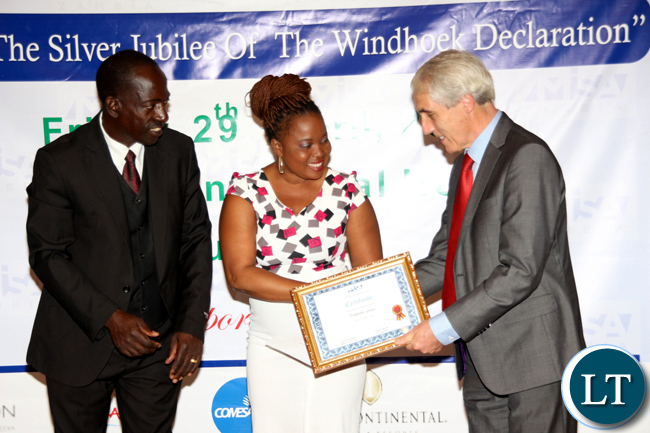 ZNBC TV2 reporter Delphister Lungu receives the best tv news reporting award during the 2016 MISA Zambia annual awards in Lusaka on April 29, 2016.