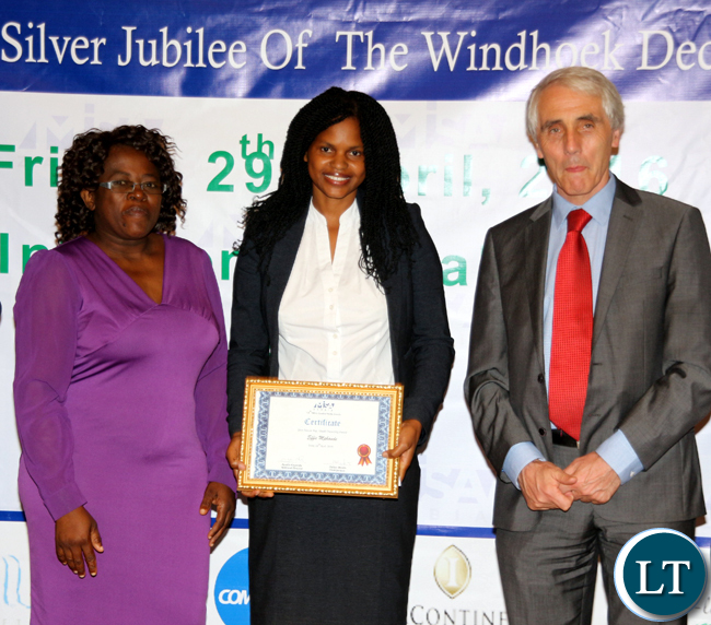 ZNBC's Effie Mphande (c) posess for a photograph after receiving the