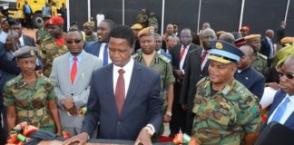 President Edgar Lungu reads the plaque whilst Special Assistant for Press and Public Relation for the President Amos Chanda (r) ZAF Commander Eric Chimese (2nr) and Lt Muwindwa Liusha after official ground breaking ceremony of ZAF twin Palm Public Private Partnership Project on Support Social Amenities and Commercial Facilities whilst Lt Muwindwa Liusha looks on