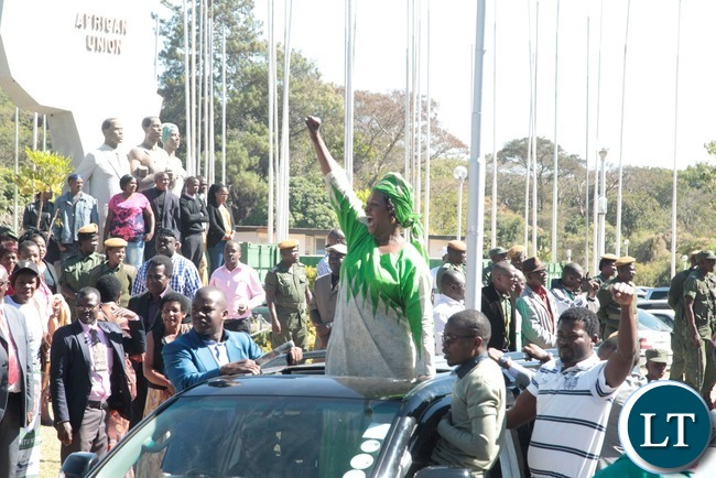 Minister of Commerce,Trade and Industry Margaret Mwanakatwe flashing the PF symbol just after President Lungu filled in his nomination at Mulungushi conference center