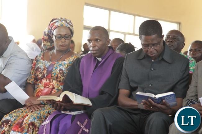 President Edgar Lungu, Kabundi Kapisha UCZ Congregation Bishop Sichilima (c) and PF Deputy Secretary General Mumbi Phiri during the Church Services in Chingola