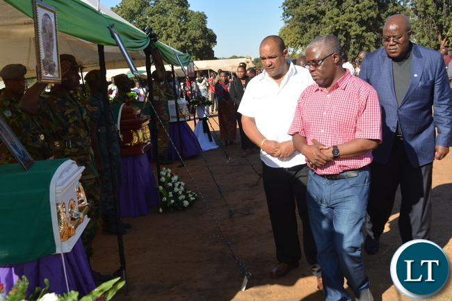 Southern Province Minister Nathaniel Mubukwanu (center), Livestock and Fisheries Deputy Minister Lawrence Evans (left in white shirt) and Southern Province Permanent Secretary Sibanje Simuchoba pay their last respect during the burial of Hillcrest National Technical Secondary School accident victims at Villa Grounds in Livingstone.Picture by KELVIN MUDENDA