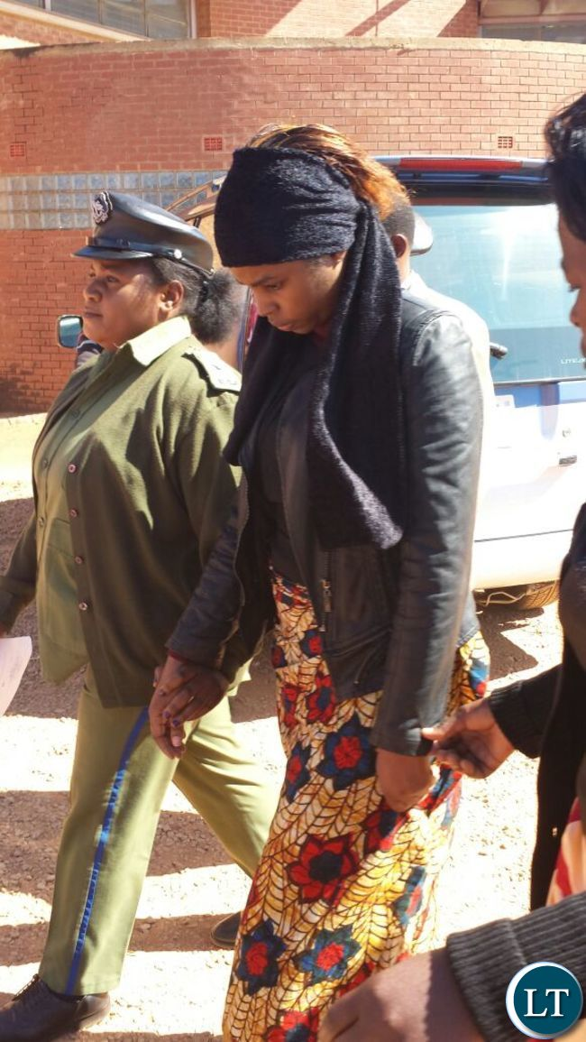 Murder suspect Precious being led back to the holding cell