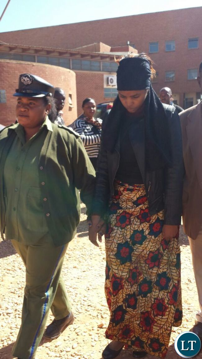 Murder suspect Precious being led out of court