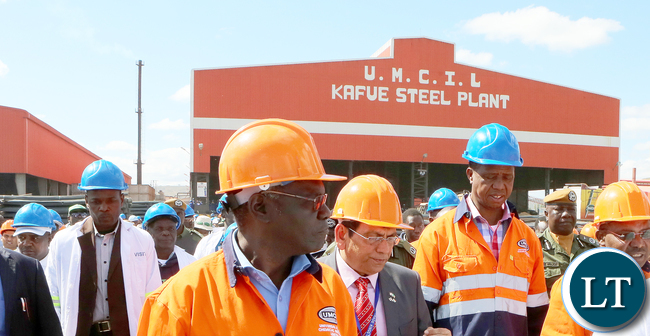 President Edgar Lungu Pose with Workers at Universal Mining and Chemical Industrial plant in Kafue-