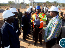 Prresident Lungu addresses Zesco employees during a tour of Mpansya sub station which is being constructed by PF Government in Rufunsa District