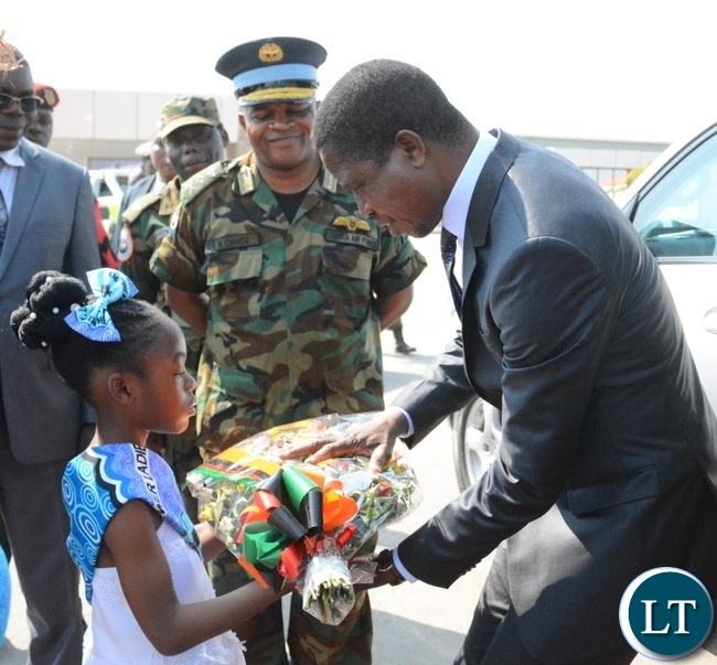 President Lungu(r) being welcomed by an 8 years old Zangi Njundu(l) at Zambia Air Force Headquarters during the official opening of Zambia Air Force Hospital