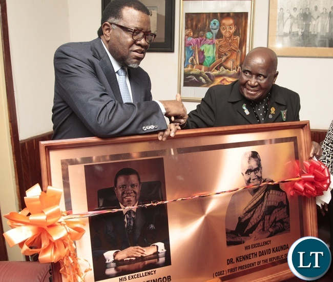 First RepublicanPresident Dr.Kenneth Kaunda shake hands with Namibian President Dr. Hage Geingob whilst present a present to him when he callled on Dr. Kaunda at his office