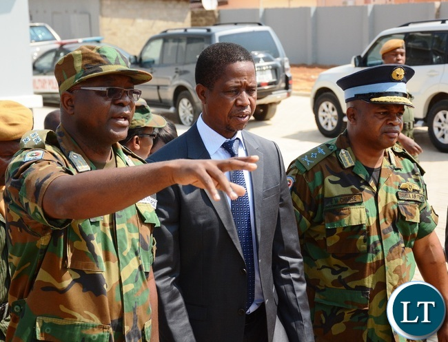 Zambia Air Force Chief of Technical Services Gen Stephen Kabanda(l) explains to President Lungu(c) and Zambia Air force Commander Lt Gen Eric Chimese(r) during the official opening of Zambia Air Force Hospital