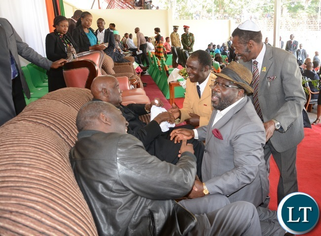 he first Republic of Zambia Dr Kennth Kaunda shake hands with former freedom fighters during the nation pray day on peaceful elections at show ground in Lusaka yesterday Picture by Josephine Nsululu/Zanis.