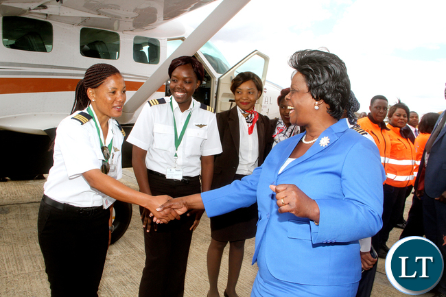 FILE: First Lady Esther Lungu  with  female pilots during the official  Launch of Women in  Aviation Zambia Chapter at Kenneth Kaunda International Airport on Thursday, July 14,2016 -Picture by THOMAS NSAMA