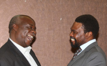 PF Lameck Mangani and UPND Dr Canisius Banda interacting during the event.
