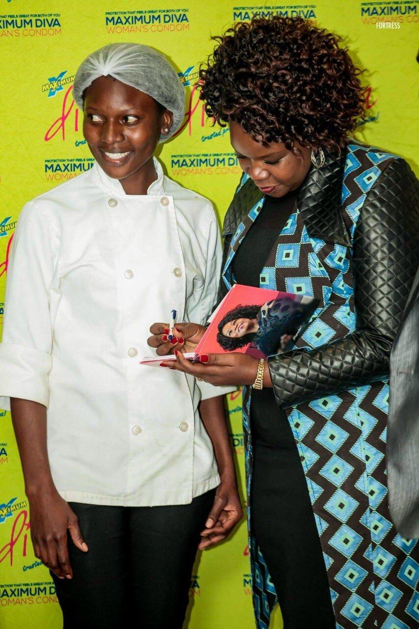 Miyanda Katiwa signing an autograph