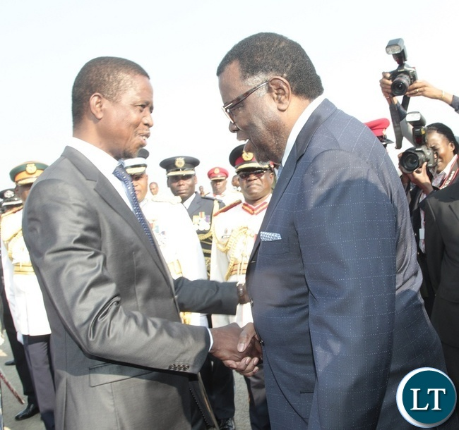 PRESIDENT of Zambia, Edgar Lungu welcomes his counterpart of Namibia, Hage Geingob on arrival at Kenneth Kaunda International Airport.
