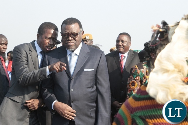 PRESIDENT of Zambia, Edgar Lungu with his counterpart of Namibia, Hage Geingob being entertained by traditional dance troupe at Kenneth Kaunda International Airport.