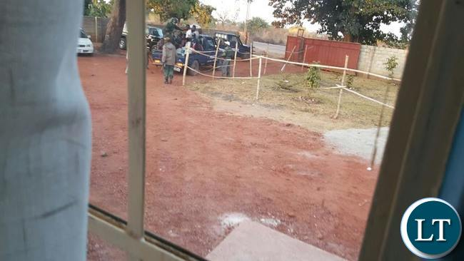 Police officers leaving GBM's home in Kasama