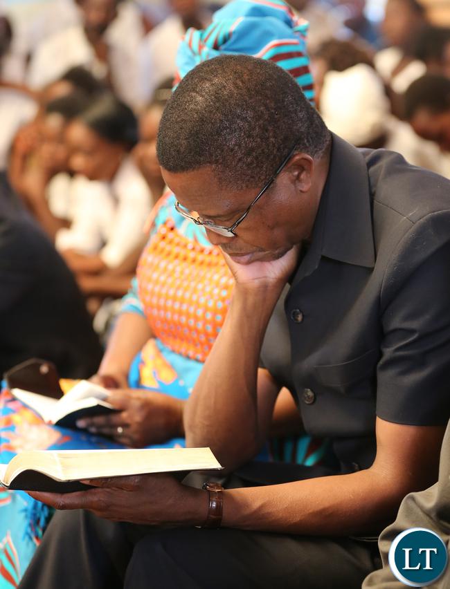 President Edgar Lungu Bilble reading in Church at Kayambi Mission