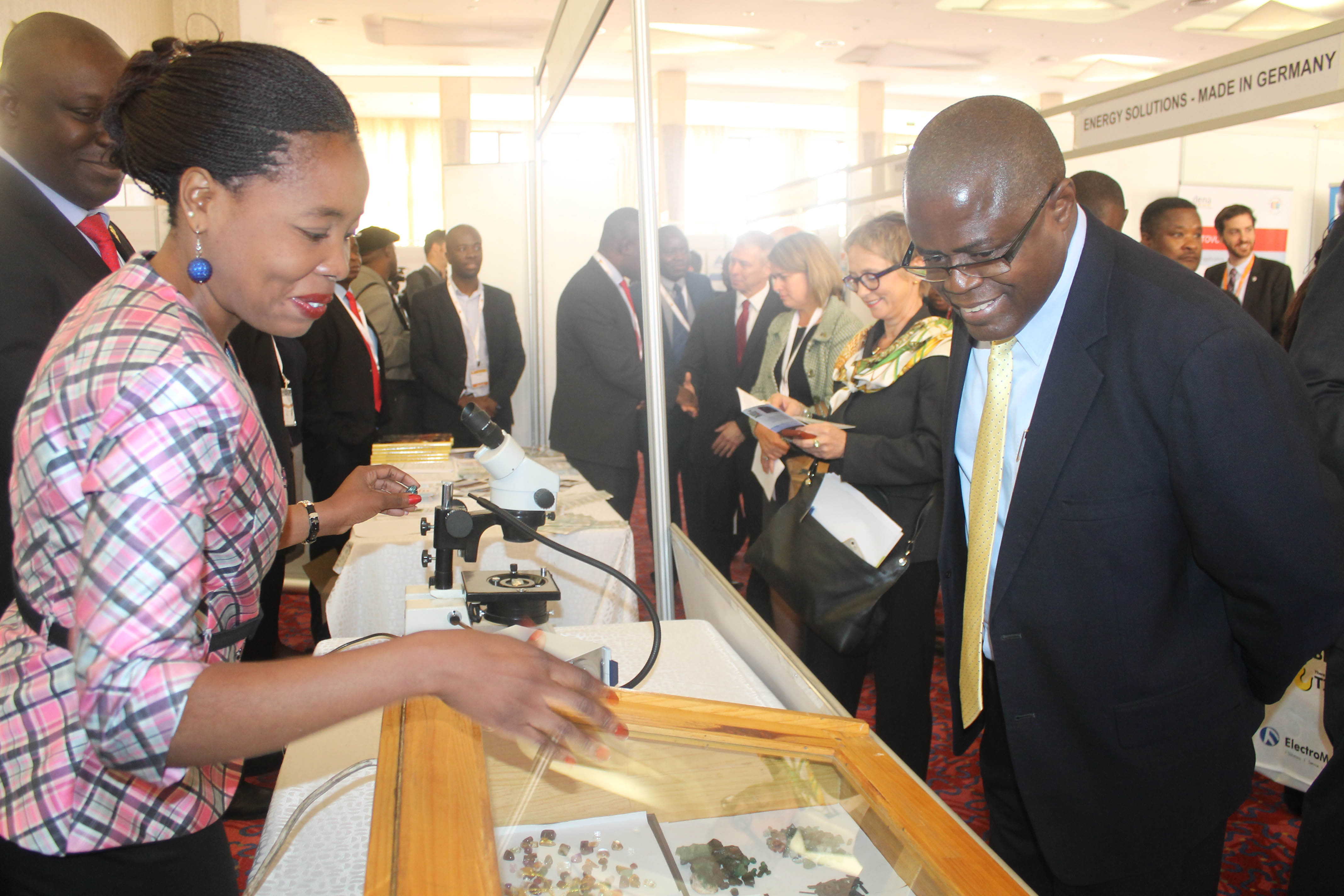 Senior Gemmologist Michelle Naambo talks to Mines Minister Christopher Yaluma at the Mines and Minerals Development stand at ZIMEC in Lusaka on 23 June. Picture By Hope Mkunte